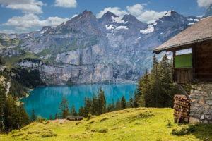 A hut by an alpine lake
